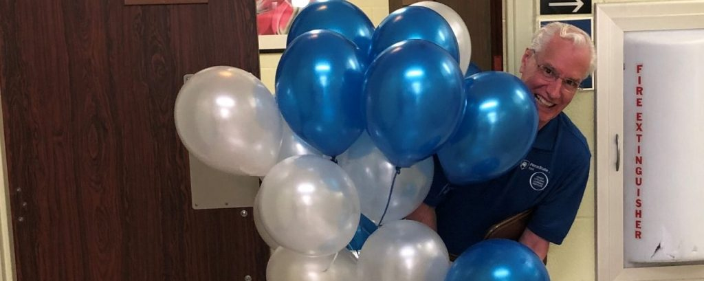 Volunteer holding baloons